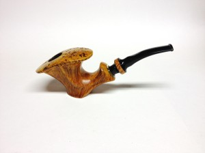 Cradled Dublin Finish: Smooth Stem: Ebonite Length: 6.5 in. Bowl Height: 2.5 in. Bowl Width: 2.5 in. Chamber Diameter: 7/8 in. $299 US